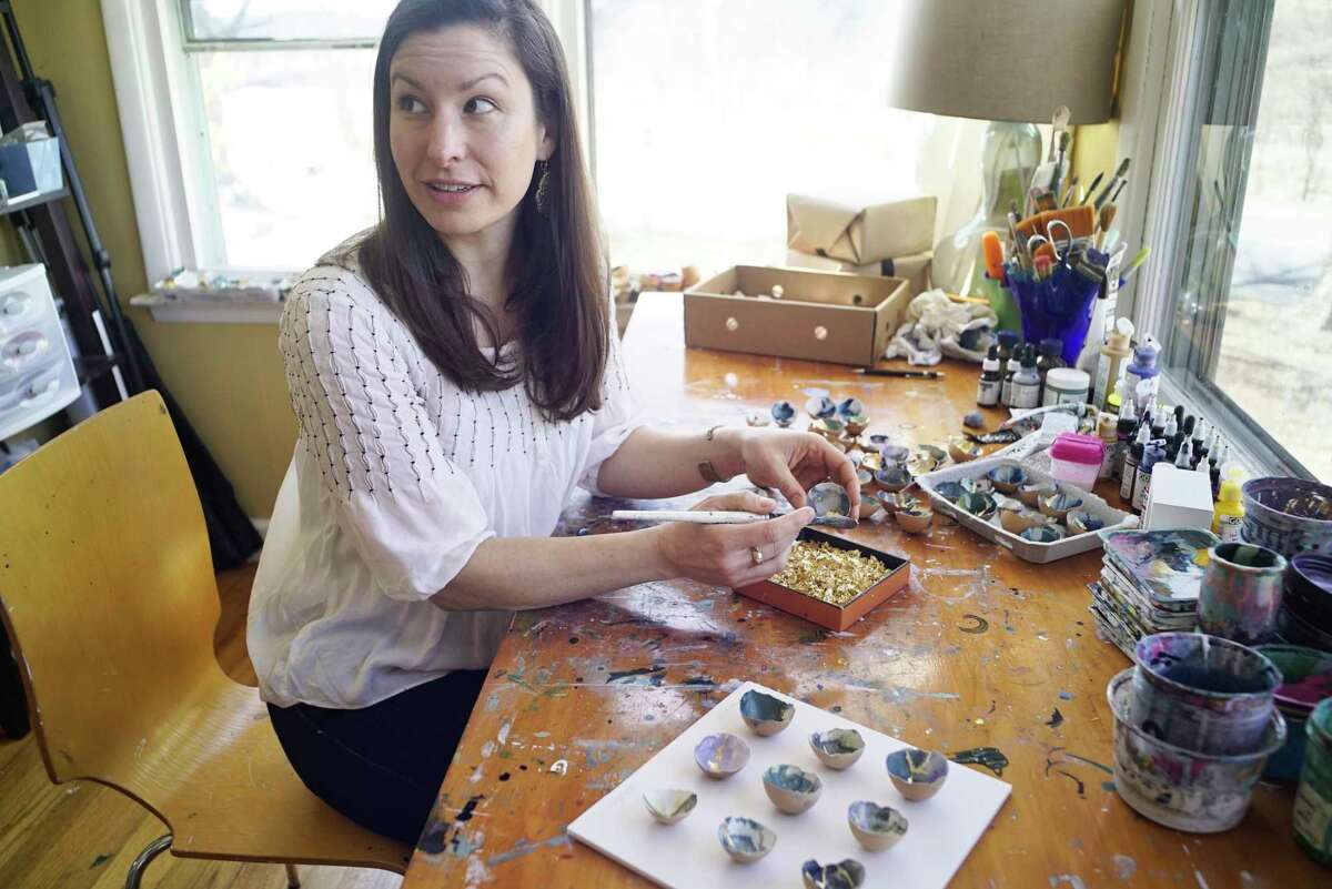 Artist Elisa Sheehan works creating artwork out of egg shells in her studio at her home on Wednesday, March 27, 2019, in Saratoga, N.Y. (Paul Buckowski/Times Union)
