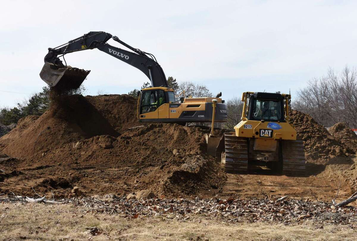Construction work for a new Hyatt House hotel and Longhorn Steakhouse commences on the former Lazare auto dealership property on Wednesday, March 27, 2019, on Wolf Road in Colonie, N.Y. (Will Waldron/Times Union)