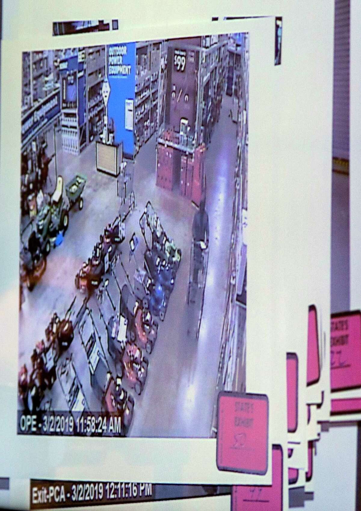 An evidence photo of USAF Reserve Maj. Andre McDonald shopping at a Lowe's store is shown Tuesday, March 27, 2019 on a screen during a bond reduction hearing for McDonald in Judge Frank Castro?•s 399th state District Court in the Cadena-Reeves Criminal Justice Center. McDonald, accused of tampering with evidence in the disappearance of his wife, Andreen McDonald who is missing and presumed dead by authorities, had his $2 million bond reduced to $300,000 by the judge. The judge added additional conditions to McDonald?•s bond including GPS monitoring, house arrest and no contact with his daughter.