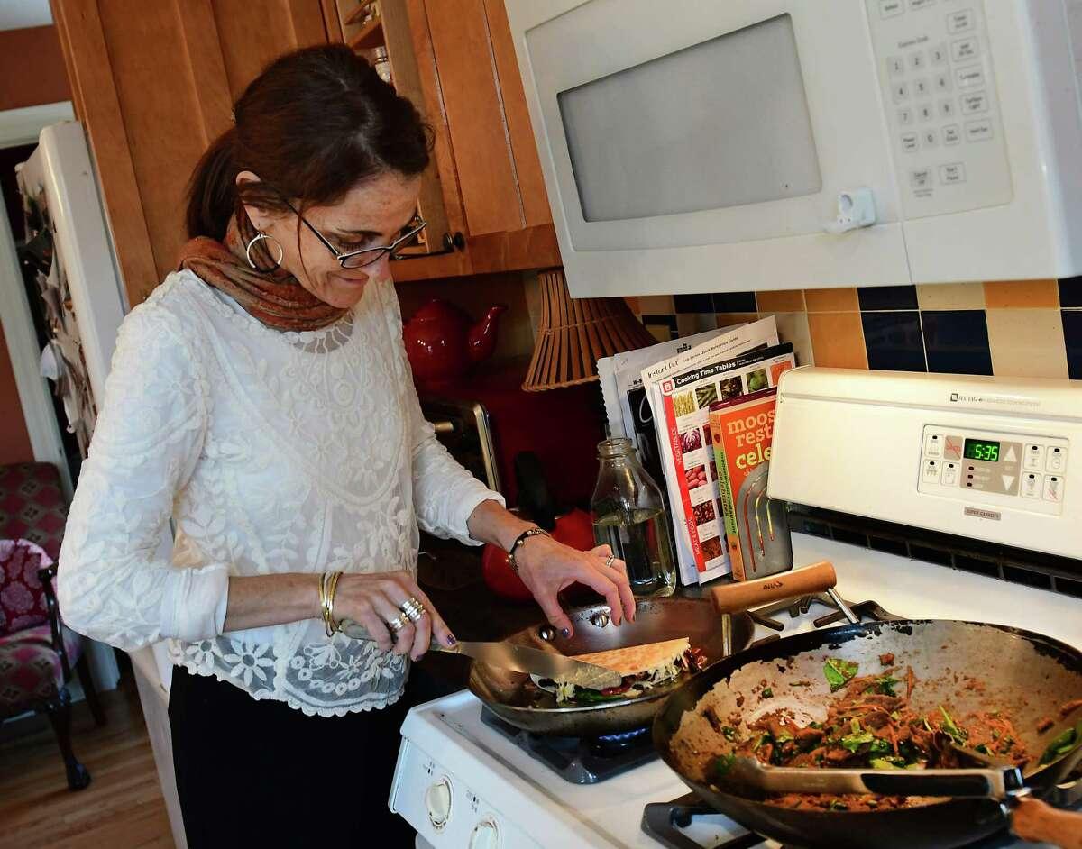Caroline Barrett makes Chili lime spiked vegetarian quesadillas at her home on Wednesday, March 20, 2019 in Delmar, N.Y. (Lori Van Buren/Times Union)