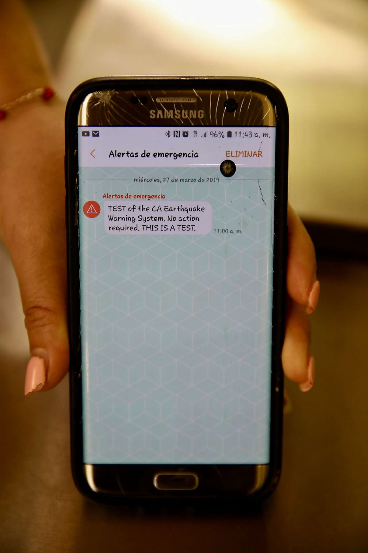 Elizabeth Sanchez, 30, owner of CyBelle's Pizza, located at 1422 Broadway St., in Oakland, Calif., shows an earthquake emergency alert that was sent to her employee's cellphone on Wednesday, March 27, 2019. State authorities announced the launch of an early warning app for the entire state on Thursday.