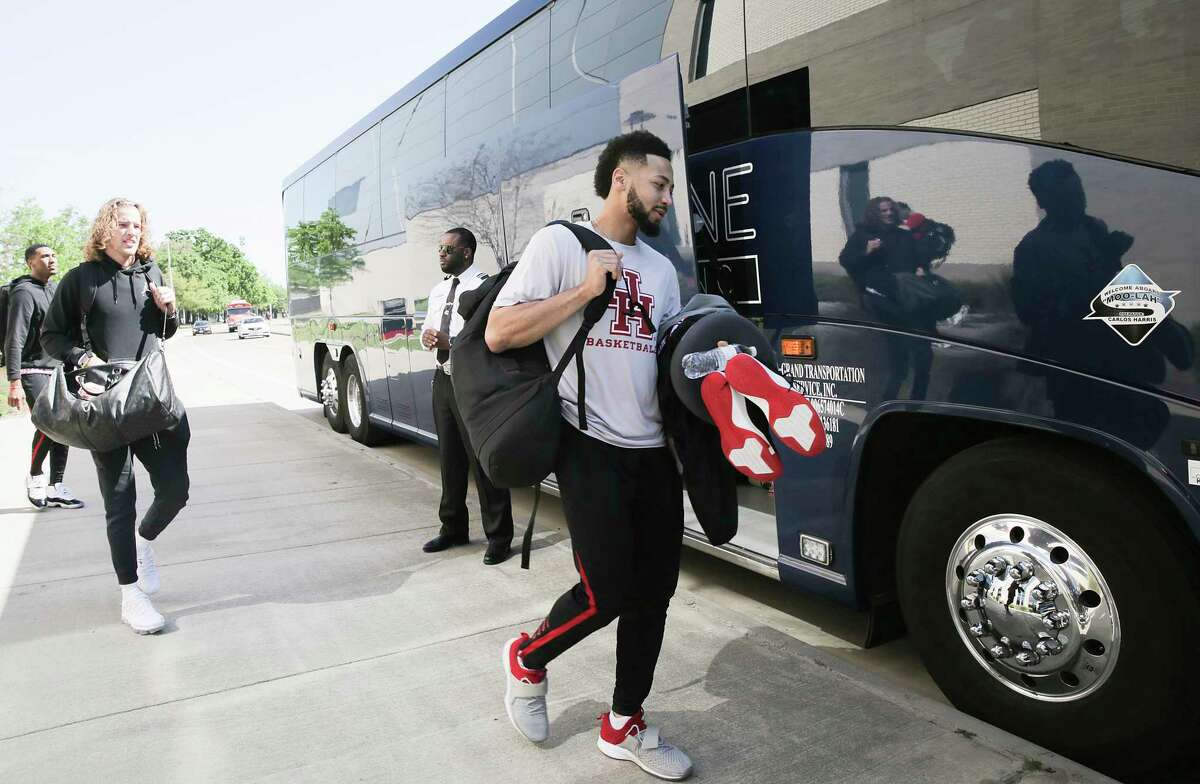Houston Cougars guard Galen Robinson Jr. , from right, gets onto the team bus along with teammates Landon Goesling and Fabian White Jr. as they get ready to head to Kansas City for the Sweet 16 on Wednesday, March 27, 2019.