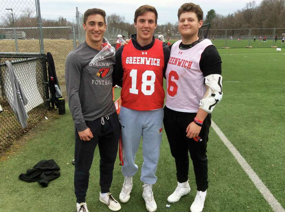 From left to right: Lance Large, Tyler Dietrich and Jack Feda are senior captains on the Greenwich High School lacrosse team. Photo: David Fierro / Hearst Connecticut Media / Connecticut Post