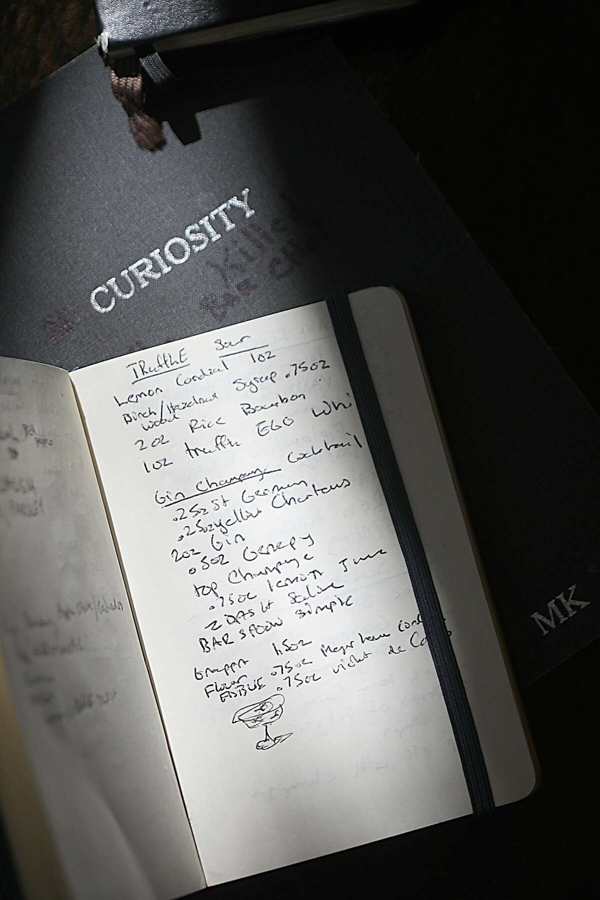 Head bartender Michael Kudra has several notebooks including this one where he constantly tries various combinations to create and tweek drinks on Monday, March 18, 2019, in San Francisco, Calif.