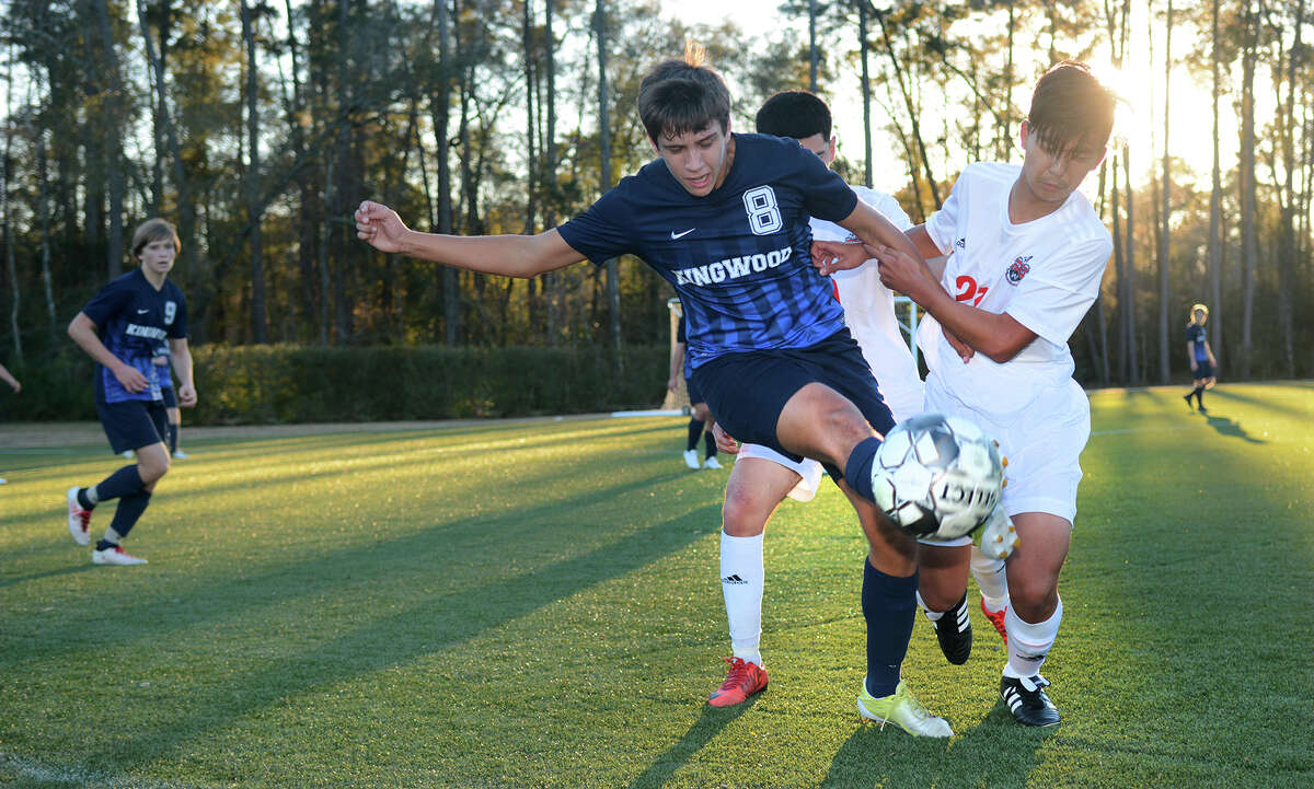 Kingwood junior midfielder William Sayles (8) battles for the ball with Westfield freshman midfielder Cyrus Ng (21) during their match at the Kilt Cup in The Woodlands on Jan. 5, 2019.
