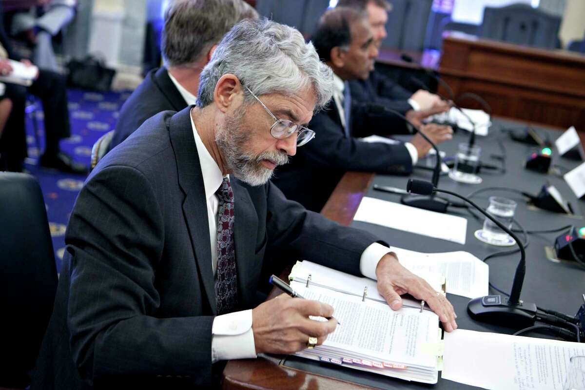 John Holdren, former policy director with the U.S. Office of Science and Technology (OSTP), pictured in 2012 as he took notes at a Senate Commerce hearing in Washington, D.C. Photographer: Andrew Harrer/Bloomberg