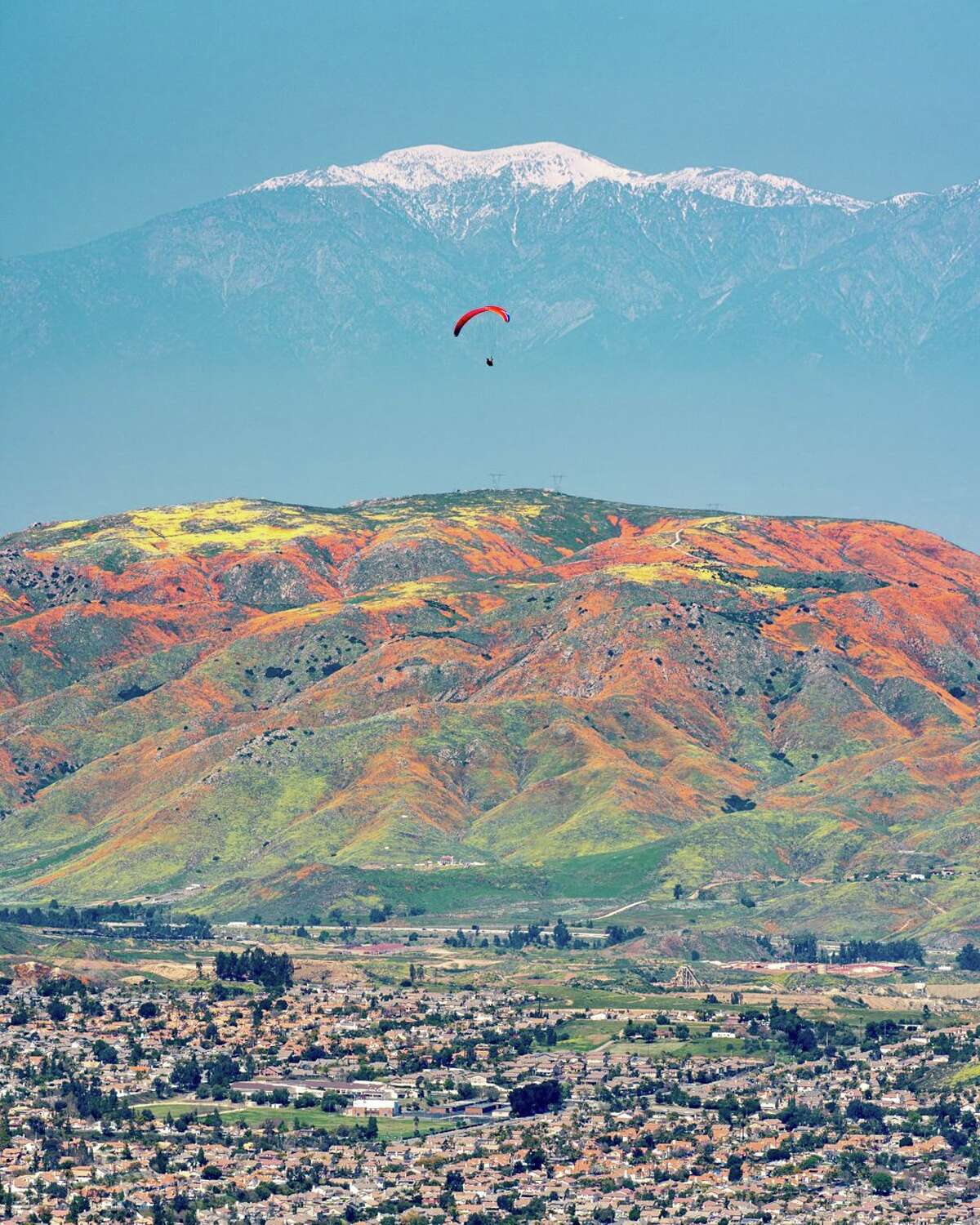 Santa Monica-based photographer Kurt Lawson captured the super bloom in Lake Elsinore, Calif., from a unique angle on a hike in the Santa Ana Mountains on March 24, 2019.