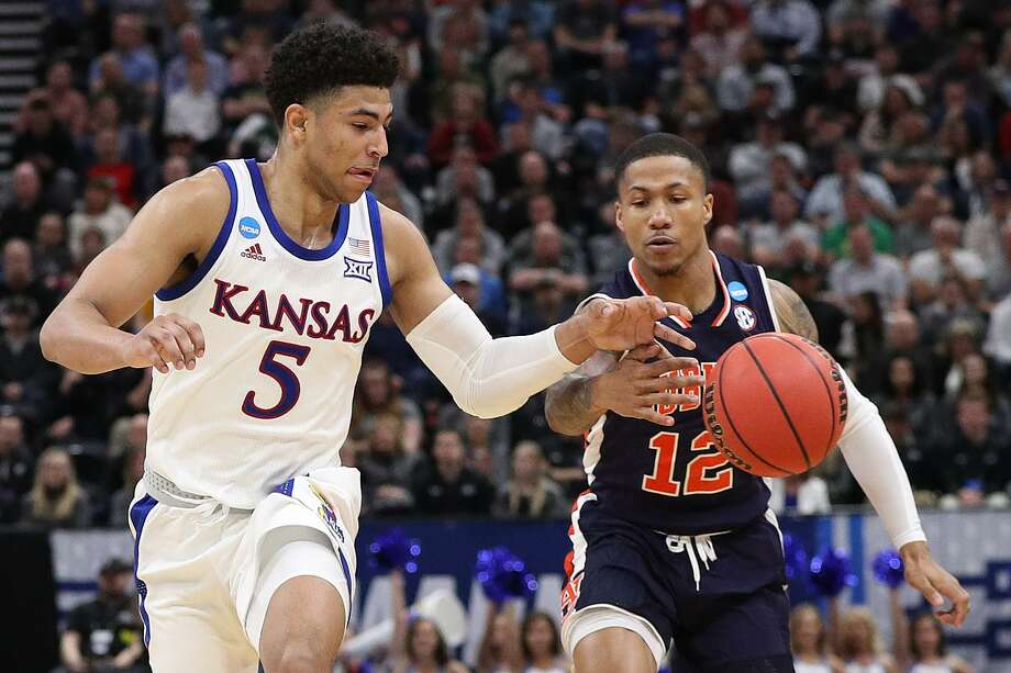 Quentin Grimes (5) of the Kansas Jayhawks and J'Von McCormick (12) of the Auburn Tigers reach for the ball during their game in the Second Round of the NCAA Basketball Tournament at Vivint Smart Home Arena on March 23, 2019 in Salt Lake City, Utah. Photo: Patrick Smith, Staff / Getty Images / 2019 Getty Images