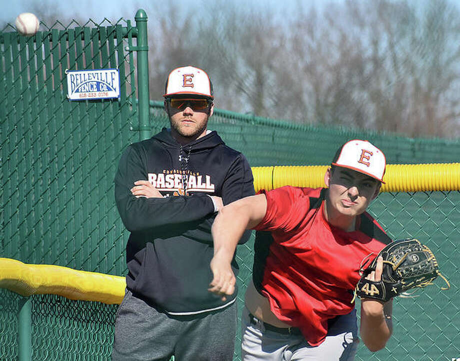 EHS pitching coach Mike Sabatino, left, watches Dawson Taylor during a bullpen session on Tuesday. Photo: Matt Kamp/The Intelligencer