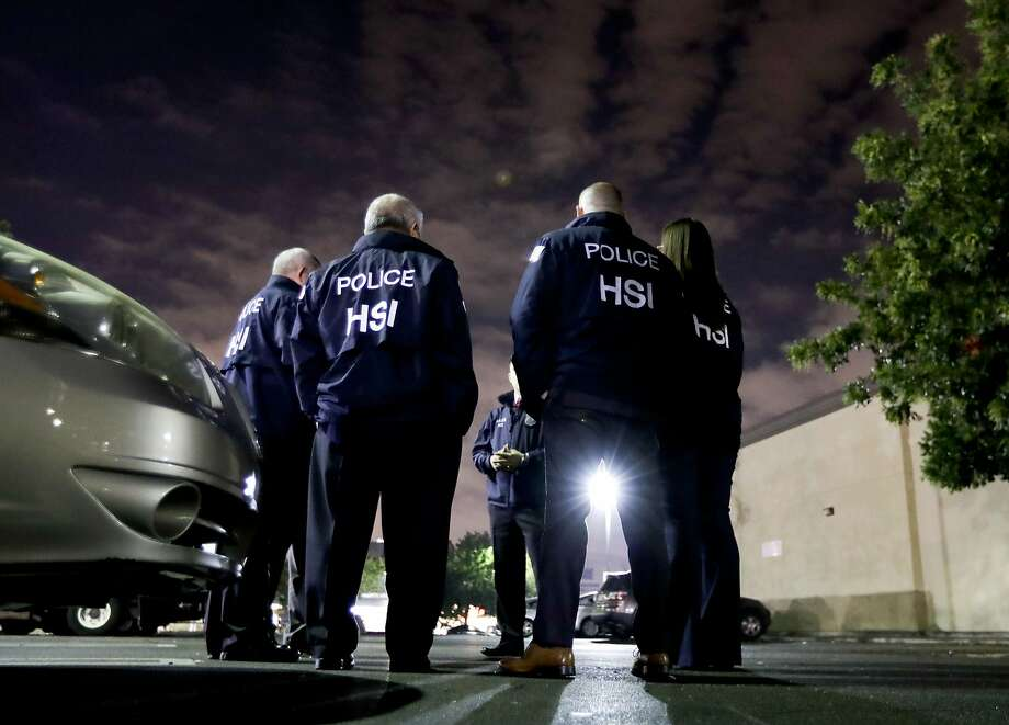 FILE - In this Jan. 10, 2018, file photo, U.S. Immigration and Customs Enforcement agents gather before serving an employment audit notice at a 7-Eleven convenience store, in Los Angeles. U.S. Immigration and Customs Enforcement is the face of President Donald Trump's hard-line immigration policy. But agency officials say their mandate is misunderstood. Government data shows ICE is mostly targeting criminals, but also that the agency has greatly ramped up overall arrests and increased the number of people arrested solely on immigration violations. And the most frequent criminal conviction was for drunken driving. (AP Photo/Chris Carlson, File) Photo: Chris Carlson, AP