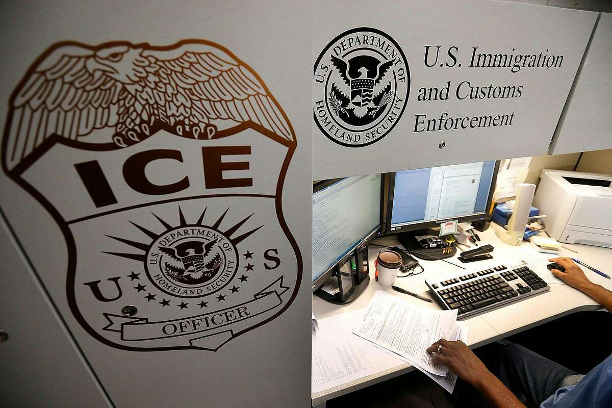 An unidentified Immigration and Customs Enforcement deportation officer reviews forms on April 26, 2017, at the the Pacific Enforcement Response Center in Laguna Niguel, Calif. (Allen J. Schaben/Los Angeles Times/TNS)