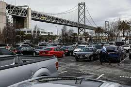 A man walks through a parking lot near the Embarcadero in San Francisco, California, on Wednesday, March 27, 2019. The parking lot had been proposed by Mayor London Breed  as a potential Navigation Center.