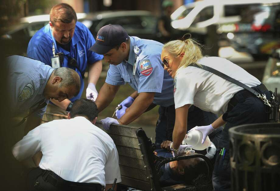 Paramedics and EMT members respond to an overdose victim on the New Haven Green in August 2018. Photo: Brian A. Pounds / Associated Press File / Connecticut Post