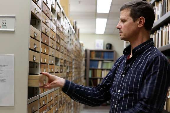 Peter Oboyski, assistant director and collections manager at the  Essig Museum of Entomology takes out a display case from the 'Oh My Collection' of specimens in the archives at the museum on March 15, 2019 at the Essig Museum in Berkeley California.