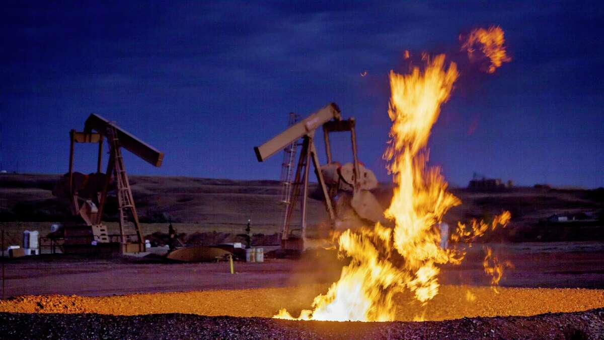 Flames from a flaring pit near a well in the Bakken Oil Field.