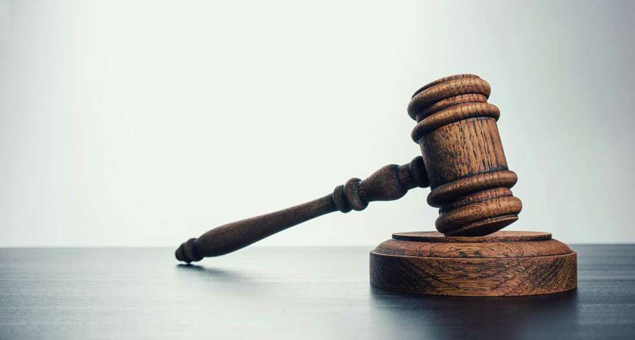 Gavel laying on judges bench in courtroom Photo: Getty Images / EyeEm