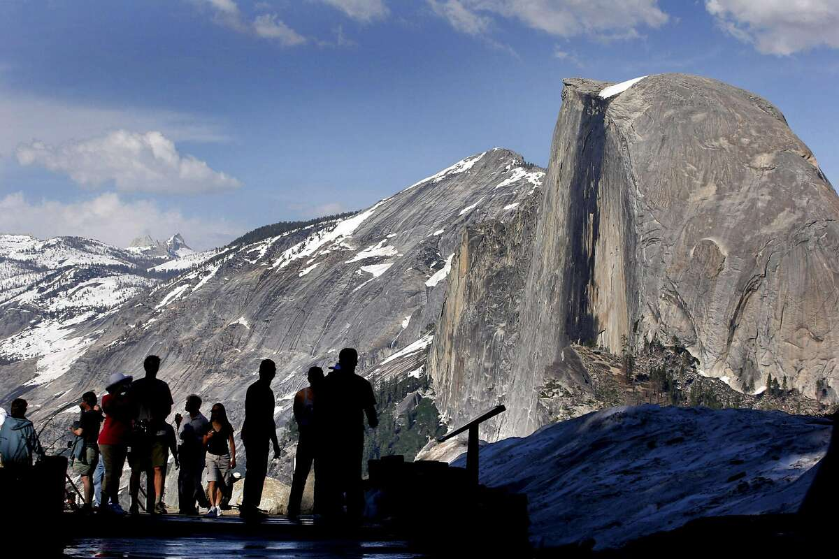 FILE - Visitors view Half Dome from Glacier Point at Yosemite National Park in 2005. Former Texas congressman Beto O'Rourke unveiled his proposal on Monday from the park, a dramatic backdrop for a move he hopes can jumpstart a campaign.