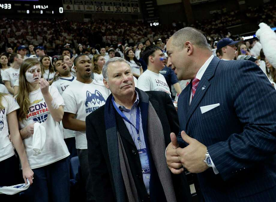 American Athletic Conference commissioner Mike Aresco talks with UConn athletic director David Benedict, right, before a basketball game in Storrs on Feb. 23, 2017. UConn is on the verge of leaving the AAC for the Big East. Photo: Jessica Hill / Associated Press / AP2017