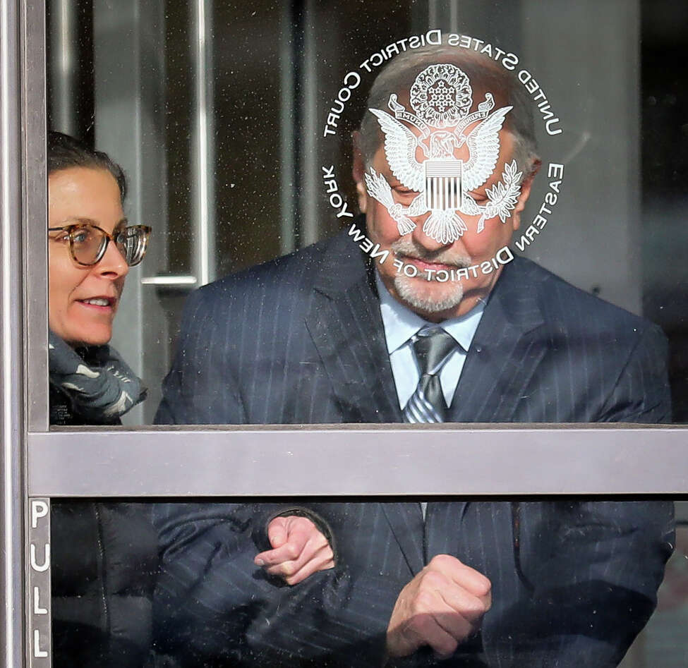 Clare Bronfman, left, a member of Nxivm, an organization charged with sex trafficking, leaves Brooklyn Federal Court with her lawyer Mark Geragos after she received medical attention while in court, Wednesday March 27, 2019, in New York.