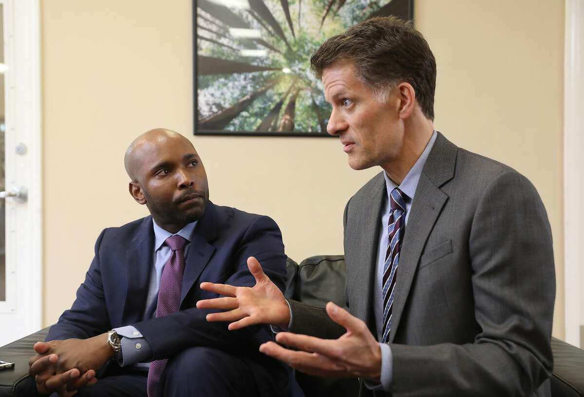 Dr. Anton Nigusse (left) has been appointed director of mental health reform and Dr Grant Colfax (right) was recently named SF director of health as they talk to press at Dore urgent care center on Wednesday, March 27, 2019 in San Francisco, Calif.