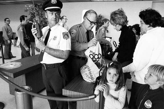 Feb. 20, 1973: Guards used walkie-talkies to communicate and sticks to inspect bags at the first security lines at San Francisco International Airport.