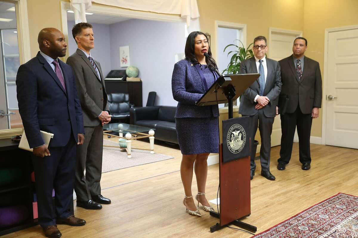 Mayor London Breed (middle)appoints Dr. Anton Nigusse Bland (far left) director of mental health reform and develop a substance use treatment for homeless clients announced at Dore Urgent Care center on Wednesday, March 27, 2019 in San Francisco, Calif. New director of public health Dr. Grant Colfax is second from left.
