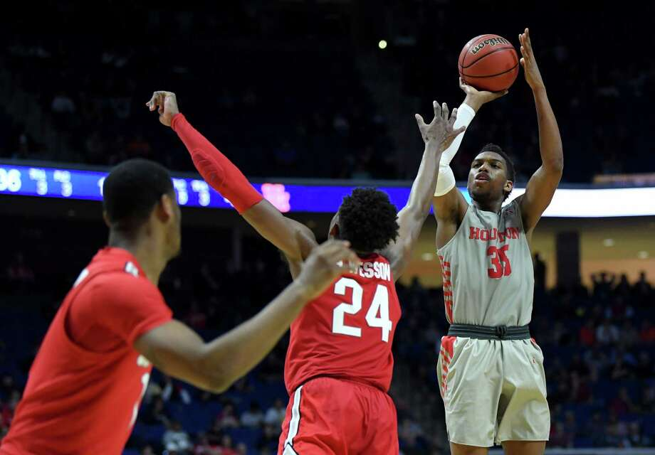 TULSA, OKLAHOMA - MARCH 24: Fabian White Jr. #35 of the Houston Cougars shoots a jumper over Andre Wesson #24 of the Ohio State Buckeyes during the second half of the second round game of the 2019 NCAA Men's Basketball Tournament at BOK Center on March 24, 2019 in Tulsa, Oklahoma. (Photo by Harry How/Getty Images) Photo: Harry How, Staff / Getty Images / 2019 Getty Images