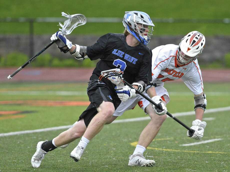 Darien's Hudson Pokorny (3) moves with the ball while being defended by Ridgefield's Jack Dowd (25) in the boys lacrosse game between Darien and Ridgefield high schools, Saturday afternoon, May 12, 2018, at Ridgefield High School, Ridgefield, Conn. Photo: H John Voorhees III / Hearst Connecticut Media / The News-Times