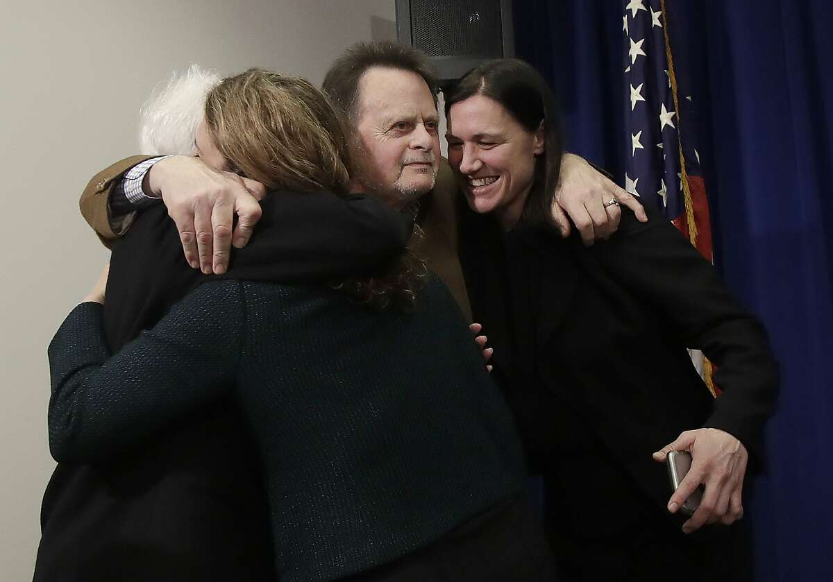 Edwin Hardeman, center, and his wife Mary, left, hug attorneys Jennifer Moore, second from left, and Aimee Wagstaff after a news conference in San Francisco, Wednesday, March 27, 2019. A U.S. jury has awarded $80 million in damages to Hardeman in a high-stakes trial over his claim that Roundup weed killer caused his cancer. (AP Photo/Jeff Chiu)