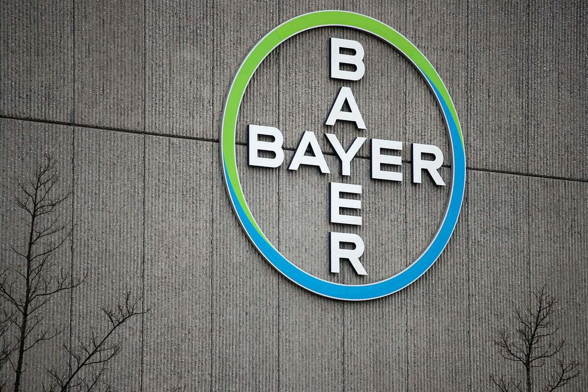 """(FILES) In this file photo taken on March 20, 2019 shows the logo of German chemicals and pharmaceuticals giant Bayer on a wall at the group's coumpound in Berlin. - Monsanto was ordered on March 27, 2019 to pay some $81 million to an American retiree who blames his cancer on the agribusiness giant's weedkiller Roundup. A San Francisco jury found the firm had been """"negligent by not using reasonable care"""" to warn of the risks of its product, ordering it to pay Edwin Hardeman $75 million in punitive damages, $5.6 million in compensation and $200,000 for medical expenses. The same jury previously found that a quarter century exposure to Roundup, whose principal ingredient is controversial chemical glyphosate, was a """"substantial factor"""" in giving the 70-year-old Hardeman non-Hodgkin's lymphoma. (Photo by Odd ANDERSEN / AFP)ODD ANDERSEN/AFP/Getty Images"""