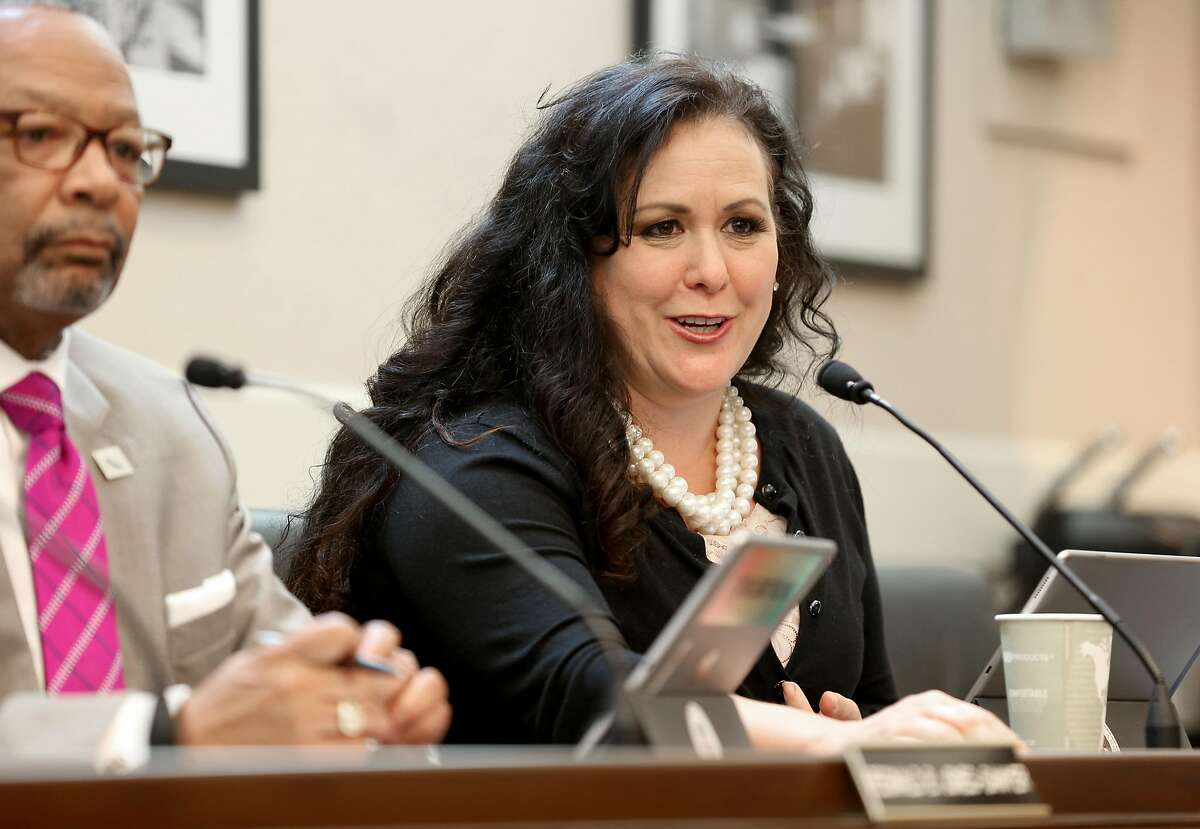 Assemblywoman Lorena Gonzalez Fletcher at the State Capitol passes a bill she carries on Wednesday, April 18. 2018, in Sacramento, Calif. It frees sexual harassment victims from forced arbitration agreements that require maintained silence about what happened to them, by the state assembly voting to subpoena victims to testify in open session.
