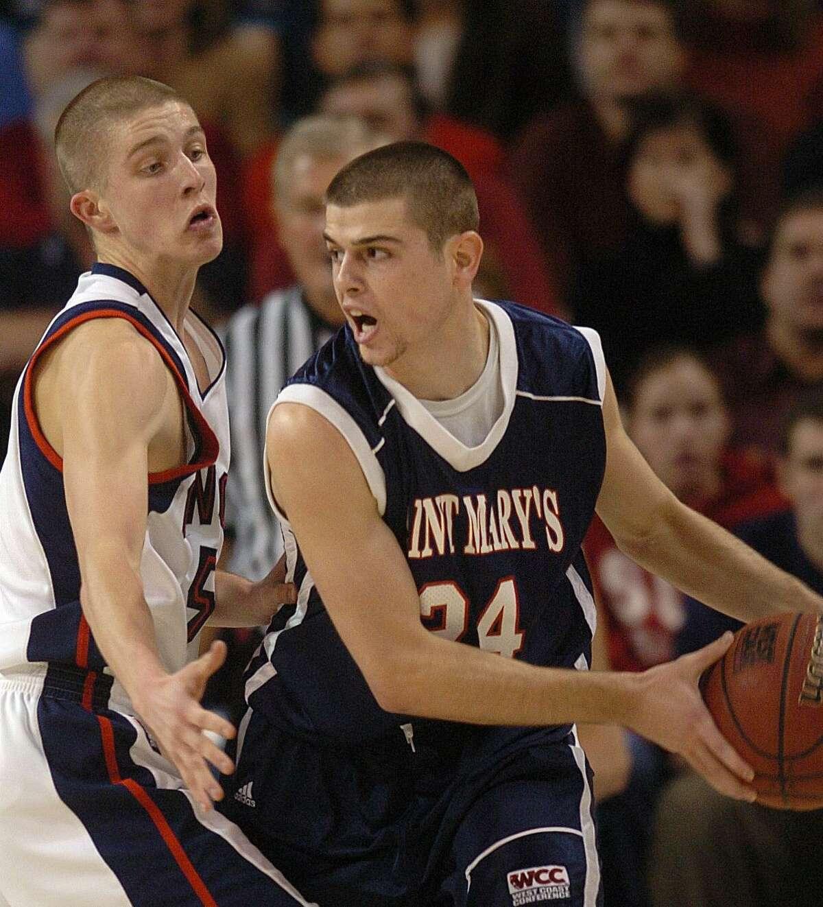 Gonzaga's Derek Ravio blocks Saint Mary's Todd Golden, right, during their college basketball game Monday Feb. 6, 2006, at the McCarthy Center in Spokane, Wash.