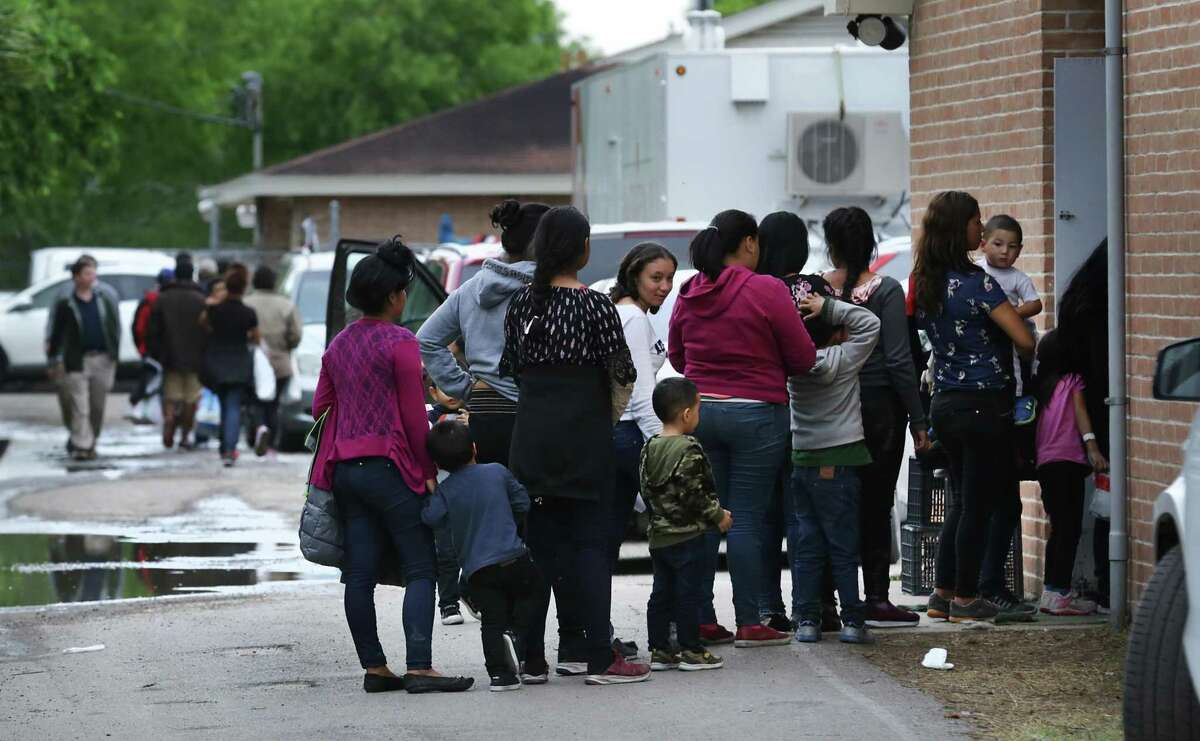 Immigrants that were just released from a Customs and Border Protection holding center wait to enter the already over crowded Catholic Charities RGV Humanitarian Respite Center in McAllen on March 21, 2019. CBP has released thousands of migrant families across the border, including 1,300 on Sunday alone at the respite center, because the agency says it doesn't have space.