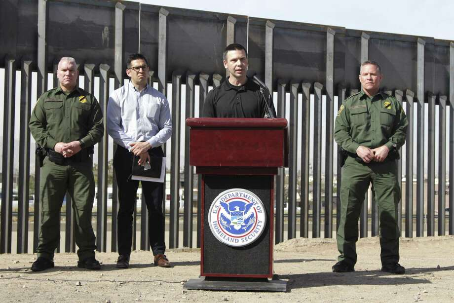 """Customs and Border Protection Commissioner Kevin McAleenan, center, announced that the Trump administration will temporarily reassign 750 CBP officers during a news conference at the border in El Paso Wednesday, March 27, 2019. McAleenan said the reassignment would mean longer waits at crossings as the busy Easter holiday nears but that it was necessary to address what he called """"an operational crisis."""" The reassigned officers will process migrants, provide transportation and perform hospital watches for migrants who require medical attention. Photo: Cedar Attanasio, STF / Associated Press / Copyright 2019 The Associated Press. All rights reserved."""