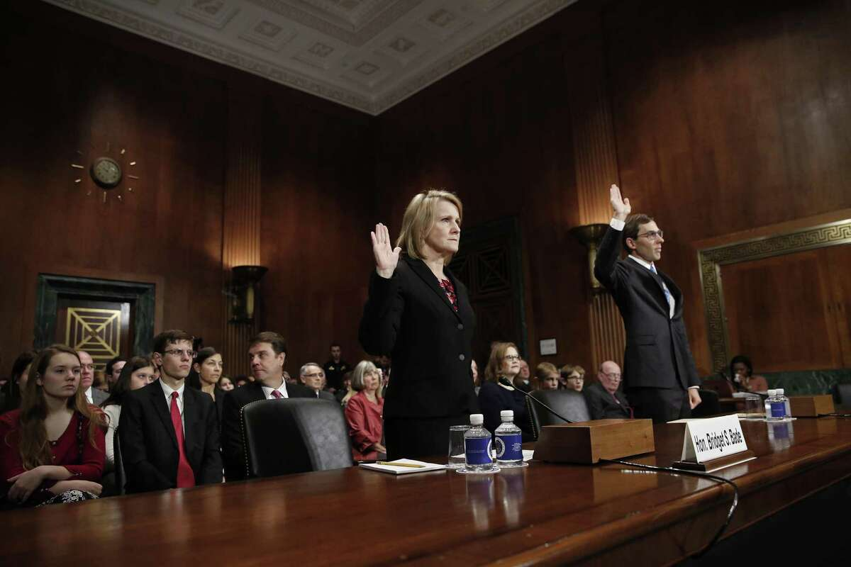 Bridget S. Bade (L) and Eric D. Miller (R), nominated to be U.S. circuit judges for the Ninth Circuit, are sworn in during a judicial nomination hearing held by the Senate Judiciary Committee October 24, 2018 in Washington, DC. The committee had only two senators in attendance during the hearings, Sen. Mike Crapo (R-ID) and Sen. Orrin Hatch (R-UT).