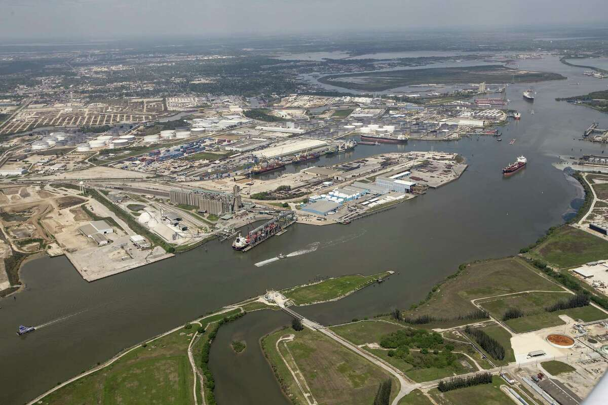 Maritime traffic moves through the Houston Ship Chanel past the site of now-extinguished petrochemical tank fire at Intercontinental Terminals Company on Wednesday, March 20, 2019, in Deer Park. Air quality and water pollution from the fire's runoff, seen on the upper right, into the ship channel are some of the concerns in the aftermath of the blaze.