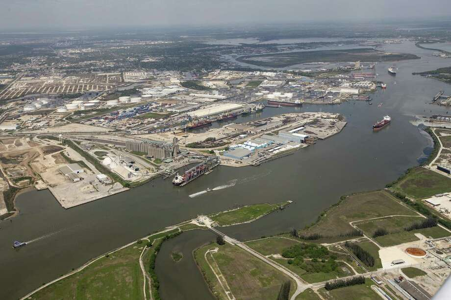Maritime traffic moves through the Houston Ship Chanel past the site of now-extinguished petrochemical tank fire at Intercontinental Terminals Company on Wednesday, March 20, 2019, in Deer Park. Air quality and water pollution from the fire's runoff, seen on the upper right, into the ship channel are some of the concerns in the aftermath of the blaze. Photo: Brett Coomer, Houston Chronicle / Staff Photographer / © 2019 Houston Chronicle