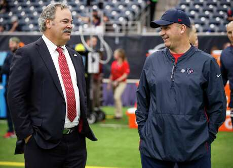 Houston Texans chairman and COO Cal McNair, left, talks to head coach Bill O'Brien before an NFL football game against the Cleveland Browns at NRG Stadium on Sunday, Dec. 2, 2018, in Houston.