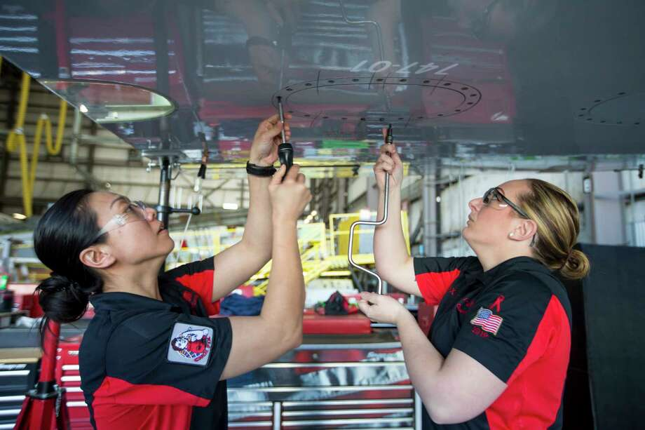 United Airlines maintenance technicians Yolanda Gong, aircraft interior repair technician, of San Francisco, left, and Katrina Oyer, aviation maintenance technician, San Francisco, work together on the fuel tank entry event as they train for the upcoming Aerospace Maintenance Competition in one of United Airlines' hangars at Bush Intercontinental Airport on Friday, March 22, 2019, in Houston. The women are members of team Chix Fix, which United says is the first all-female team of technicians representing any commercial airline. Photo: Brett Coomer, Staff Photographer / © 2019 Houston Chronicle
