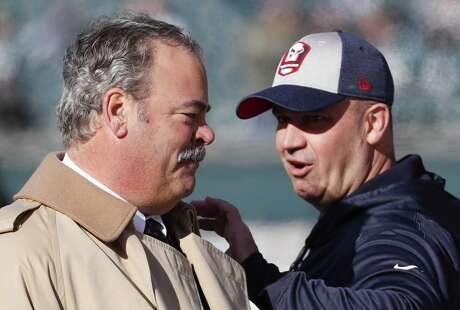 Houston Texans head coach Bill O'Brien reaches out to greet chairman Cal McNair before an NFL football game against the Philadelphia Eagles at Lincoln Financial Field on Sunday, Dec. 23, 2018, in Philadelphia.