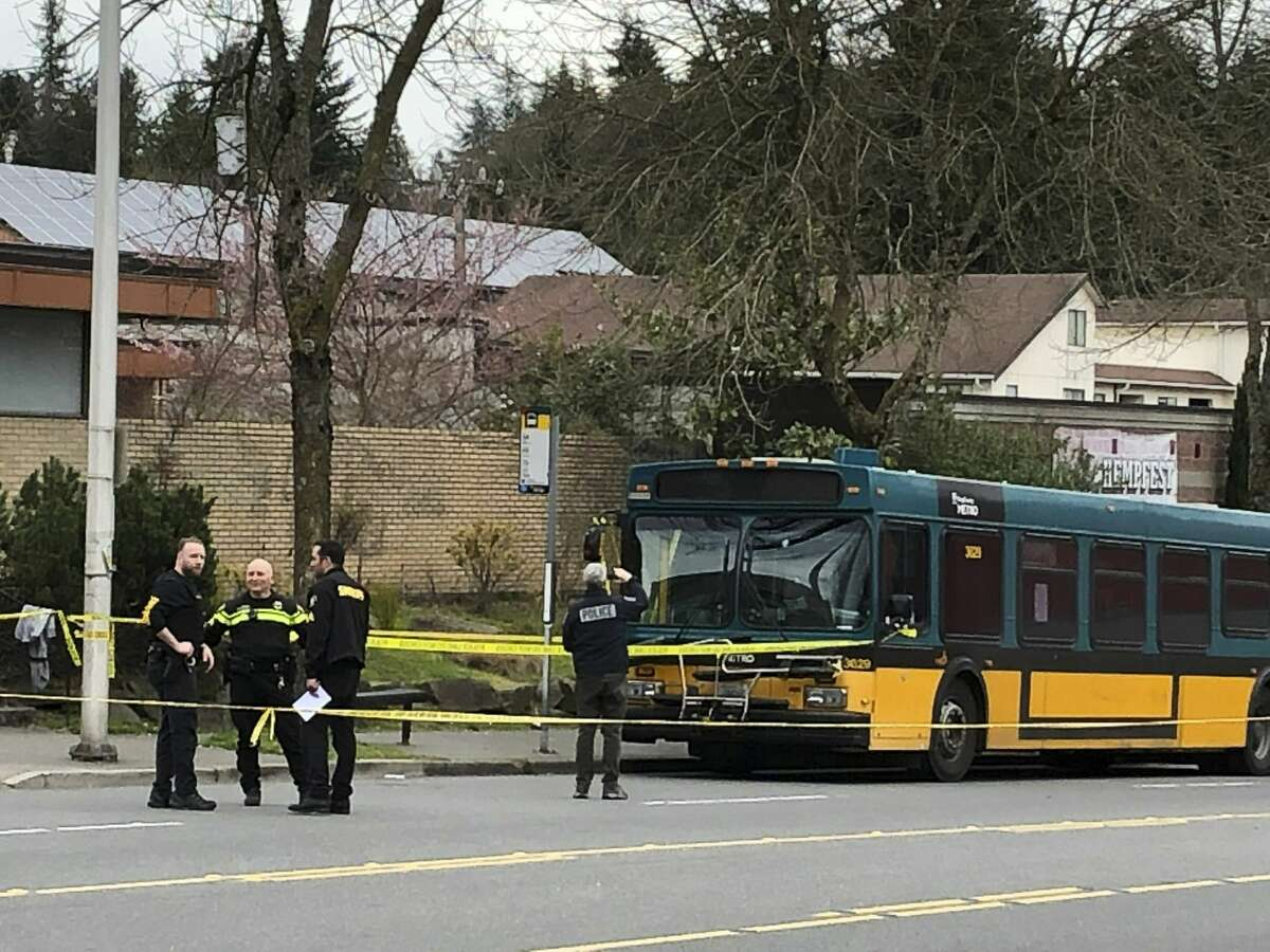 Investigators work on the scene of a shooting in Seattle on Wednesday, March 27, 2019. Authorities say four people, including a Metro bus driver, were shot and one person has been detained. (AP Photo/Gene Johnson)