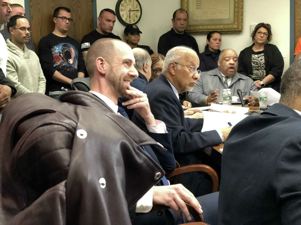 The Board of Police Commissioners tabled a hearing on whether to fire New Haven police Officer Jason Bandy over his facial tattoos Wednesday. Here, attorney Jarad Lucan of Shipman & Goodwin.