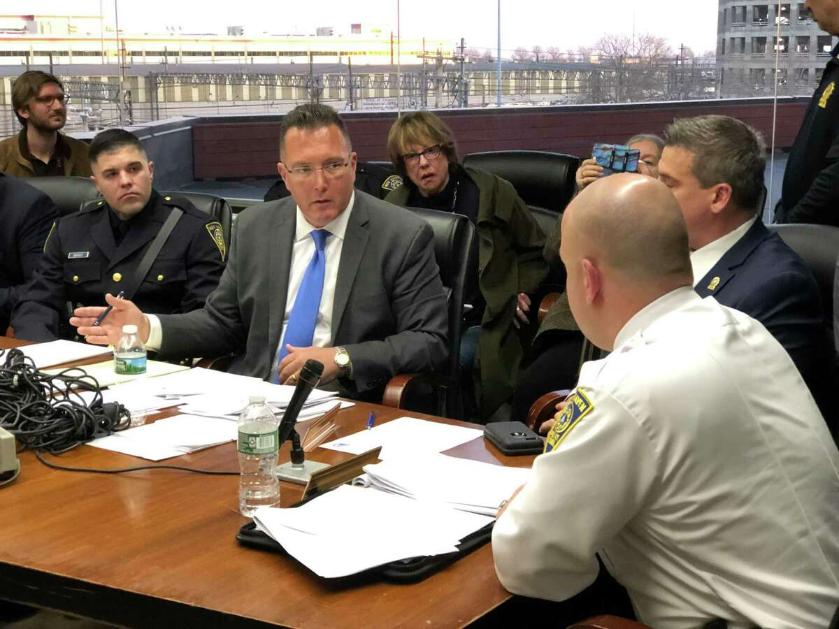 The Board of Police Commissioners tabled a hearing on whether to fire New Haven police Officer Jason Bandy over his facial tattoos.