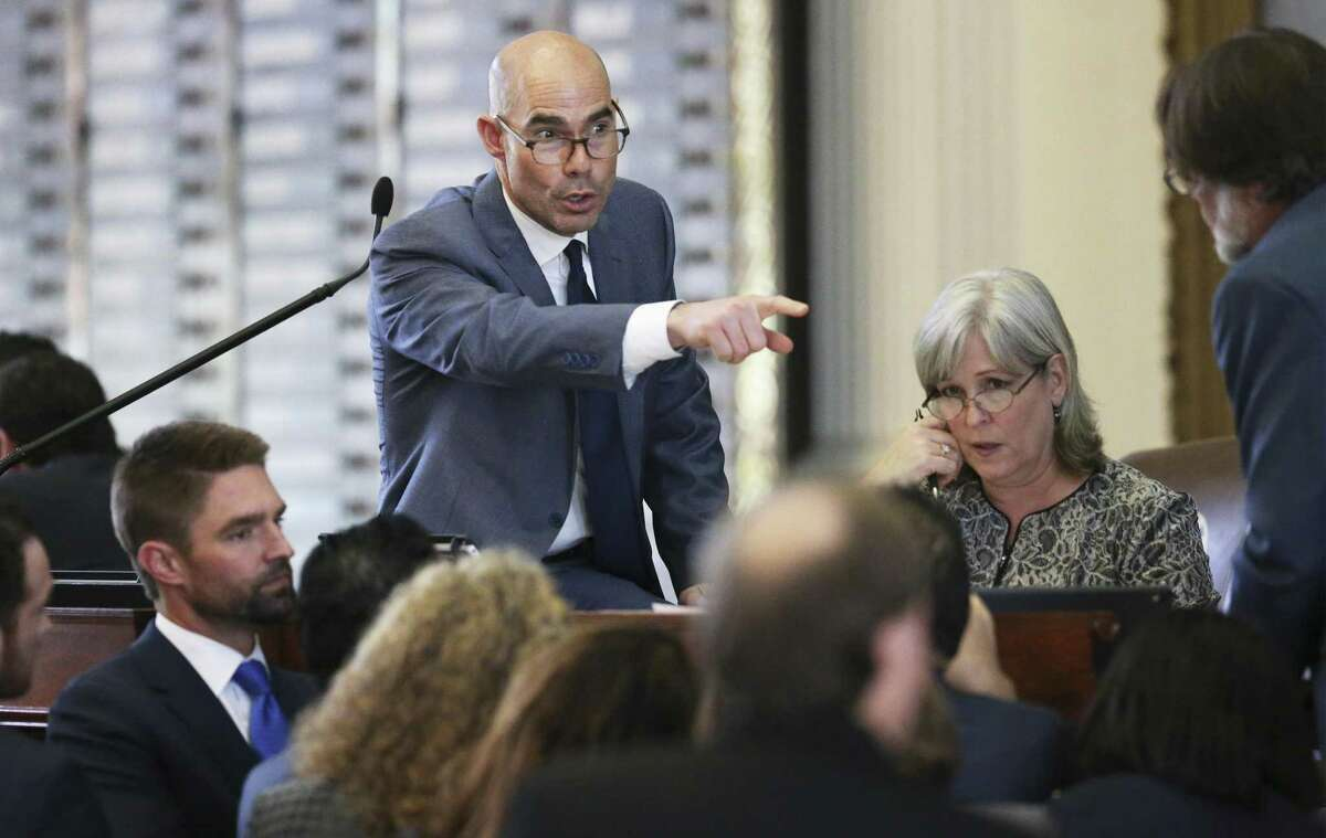 Speaker Dennis Bonner, R- Angleton, addresses legislators gathered at the podium for a point of order as the Texas House of Representatives takes up the budget bill on March 27, 2019.