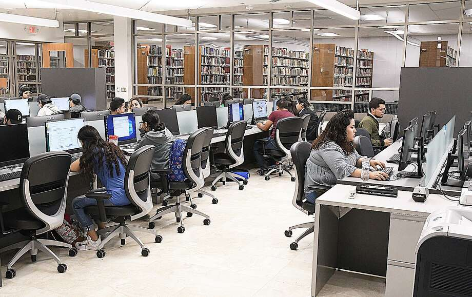 With a limited quantity of hardcover books on its shelves, the newly modernized and expanded Harold R. Yeary Library and Executive Conference Center at the Laredo College offers a computer lab where students can access unlimited e-books and digital information for their studies. Photo: Cuate Santos /Laredo Morning Times / Laredo Morning Times