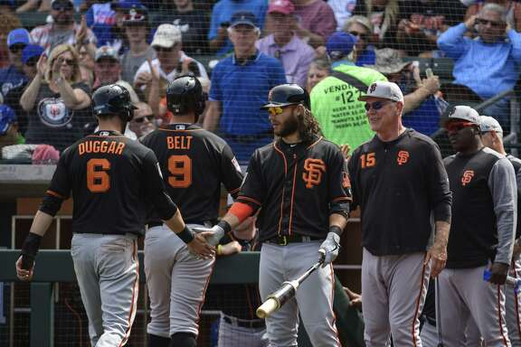 Steven Duggar, Brandon Belt, Brandon Crawford and manager Bruce Bochy represent the Giants' efforts to blend new and old.