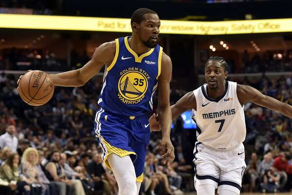 2ade26d23b39 1of11Golden State Warriors forward Kevin Durant (35) handles the ball  against Memphis Grizzlies forward Justin Holiday (7) during the second half  of an NBA ...