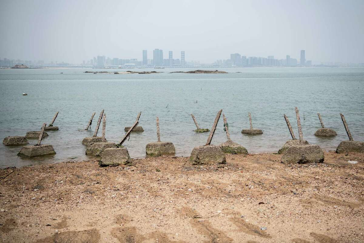 KINMEN COUNTY, TAIWAN - APRIL 20: Aged anti-landing barricades are positioned on a beach facing China on the Taiwanese island of Little Kinmen which, at points lies only a few miles from China, on April 20, 2018 in Kinmen, Taiwan. China recently carried out live-fire military drills in the Taiwan Strait involving its Liaoning aircraft carrier, an exercise interpreted as a show of force and a message to self-governed Taiwan which China claims as its territory. The naval exercise was the first in the Taiwan Strait since 2016 and was held just over 100 miles off the coast of Taiwan. Following the defeat of the ruling Kuomintang party by the Chinese Communist Party and their retreat to Taiwan in 1949, cross-strait relations have varied from open conflict to diplomatic war. China's President, Xi Jinping, recently emphasised China's sovereignty over Taiwan by stating that 'We have sufficient abilities to thwart any form of Taiwan independence attempts'. Beijing has also imposed financial restrictions by significantly limiting the number of Chinese tour groups allowed to visit Taiwan and imposed trade sanctions on the island. (Photo by Carl Court/Getty Images)