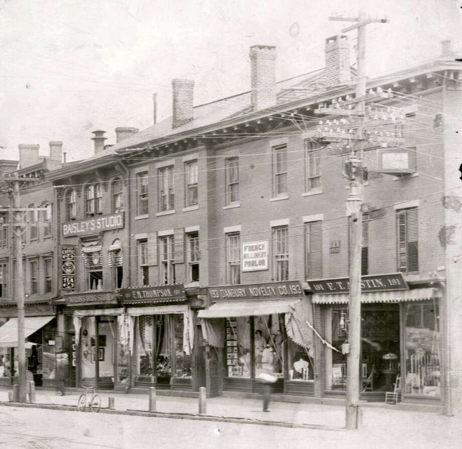 This stretch of Main Street in Danbury was referred to as The Thompson Block. On the second floor of 197 Main, notice Baisley Studios. Frank Henry Baisley was a hatter in his younger life before getting into the photography trade. He had a studio in New Rochelle, NY before he came to Danbury to conduct business. Photo: Photo Courtesy Of The Danbury Museum And Historical Society.