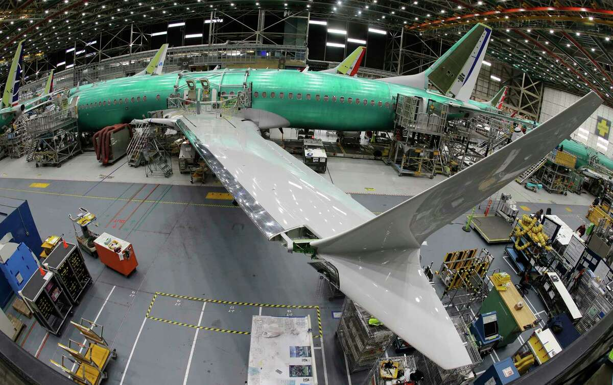 In this photo taken with a fish-eye lens, a Boeing 737 MAX 8 airplane sits on the assembly line during a brief media tour in Boeing's 737 assembly facility, Wednesday, March 27, 2019, in Renton, Wash. The Federal Aviation Administration plans to revamp oversight of airplane development after the two deadly crashes of Boeing's new 737 Max 8 airplane, according to testimony prepared for a Capitol Hill hearing on Wednesday. (AP Photo/Ted S. Warren)